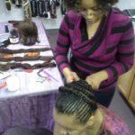 Khalilah braids as her daughter models